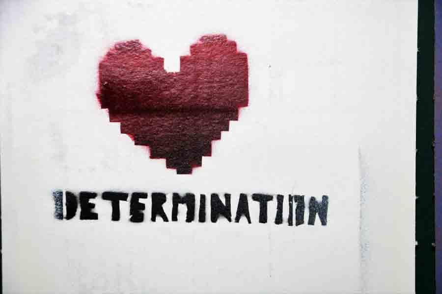 """Ein Bild mit einem Herz und der Aufschrift """"Determination""""."""